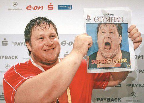 """Der Olympiasieg in Peking machte den Gewichtheber Matthias Steiner zum """"Super Steiner"""". Foto: ap"""