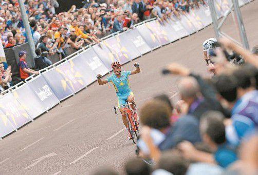 Der letzte Sieg ist wohl sein größter: Alexander Winokurow triumphiert im Straßenrennen bei den Olympischen Spielen in London. Foto: ap