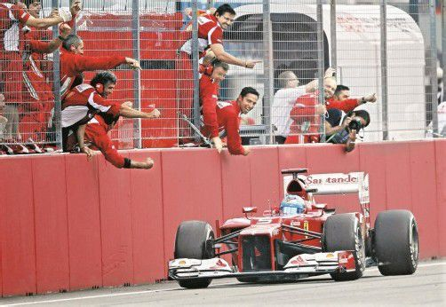 Jubel bei Ferrari: Fernando Alonso feierte in Hockenheim den dritten Saisonerfolg. Foto: reuters