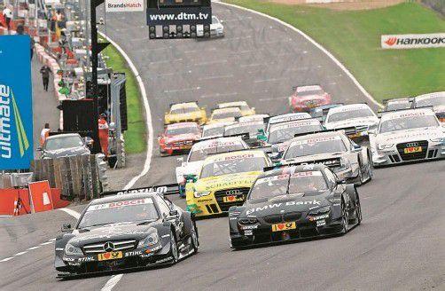 Ralf Schumacher, Mike Rockenfeller und Timo Scheider freuen sich besonders auf ihr Heimrennen auf dem Nürburgring. Foto: DTM