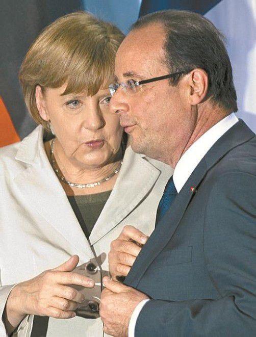 Schulterschluss von Merkel und Hollande für Eurozone. AP