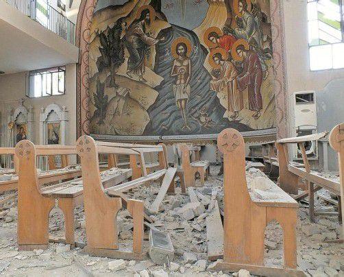Von monatelangen Kämpfen gezeichnet: Die Kirche Im Al-Zinar in der syrischen Oppositionshochburg Homs. Foto: Reuters