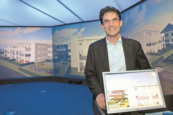Wilfried Hefel im Terminal V, im Hintergrund das Projekt Dornbirn Eichbrunnen. Foto: VN/Hofmeister