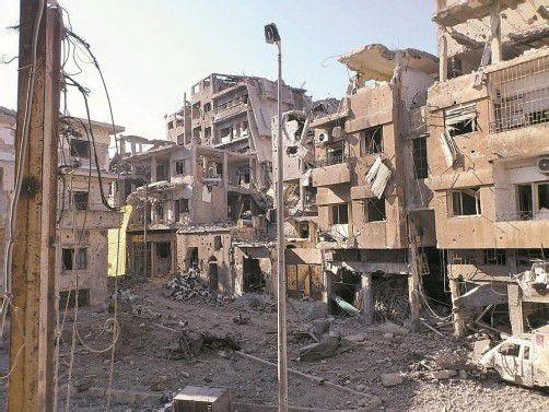 ... und Spuren des Kampfes in der Stadt. FotoS: Reuters