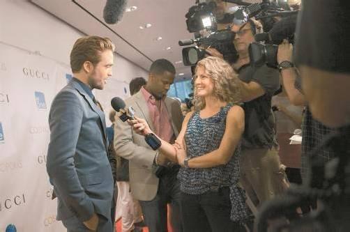 """Auch auf dem roten Teppich der """"Cosmopolis""""-Premiere in New York schlug sich Pattinson tapfer. Foto: REUTERS"""