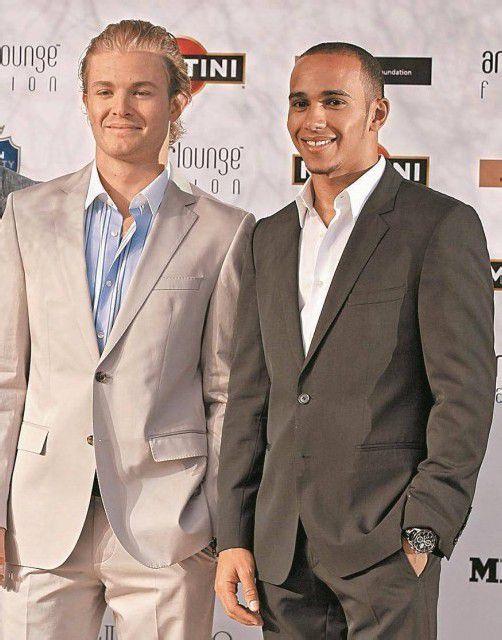 Die Gentlemen bitten 2013 zum Mercedes-internen Duell: Nico Rosberg und Lewis Hamilton. Foto: ap