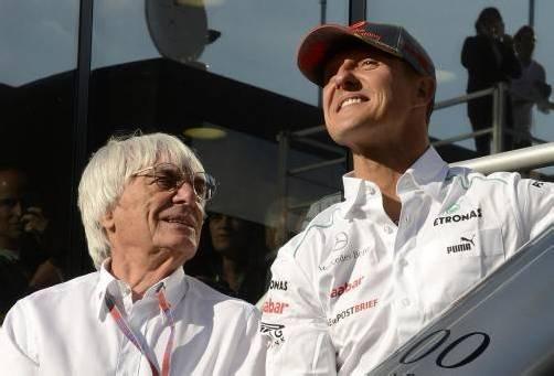 Michael Schumacher mit Formel-1-Boss Bernie Ecclestone. reu