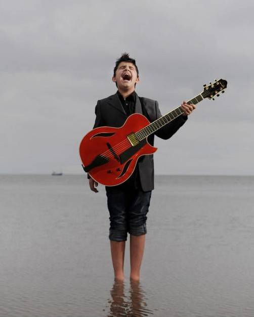 20/9/2011. Jazz guitar prodigy Andreas Varady pictured on the shore line at Blackrock near his home in Dundalk. PICTURE CHARLES MCQUILLAN/PACEMAKER.