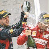 Kalte Dusche in Indien – Sebastian Vettel (l.) vergrößerte mit seinem Sieg in Indien den WM-Vorsprung auf Fernando Alonso. Foto: ap