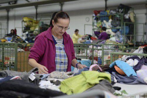 Blick in die Carla-Wäscherei: Immer mehr Menschen verdienen trotz Arbeit zu wenig zum Leben. Foto: Stiplovsek