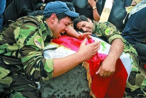 Tägliches Leid: Soldaten trauern um Kameraden, die bei Kämpfen in Damaskus gefallen sind. Foto: Reuters