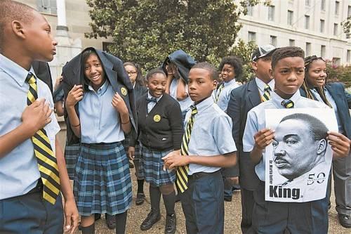 Schüler bei einem Marsch für Jobs und Gerechtigkeit in Erinnerung an Martin Luther King in Washington. Foto: AP