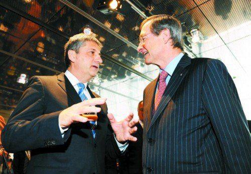 Finanzminister Michael Spindelegger (l.) und Wirtschaftsvertreter Leitl: Tauziehen um Änderungen. Foto: APA