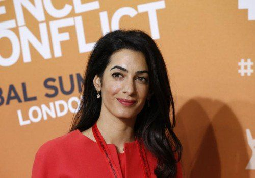 . . . Amal Alamuddin wollen im September heiraten. Fotos: AP