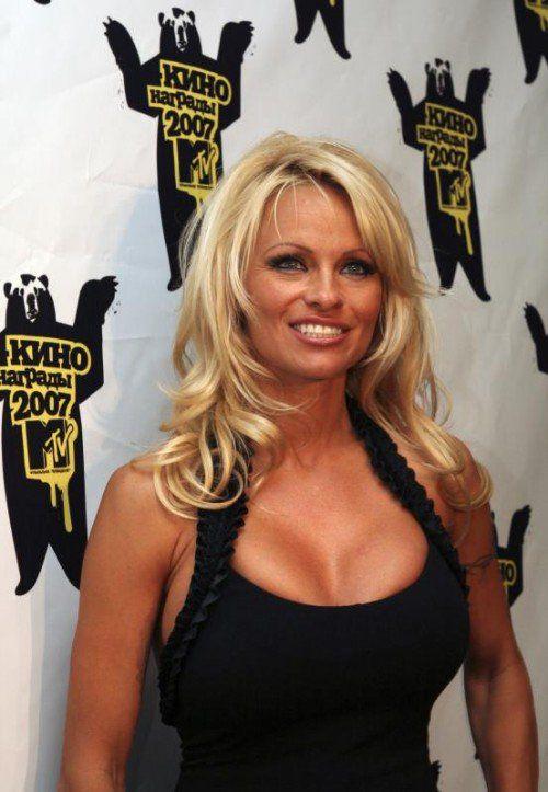 "**FILE**Pamela Anderson poses after Russia's MTV Movie Awards presentation ceremony in Moscow which she hosted, on April 19, 2007.The 40-year-old ex-""Baywatch"" star tells OK! magazine that she and Rick Salomon took their 17-year friendship to the next level during a poker game. They were married on Oct. 6, 2007.( AP Photo/Dmitry Korobeinikov, Zerkalo)"