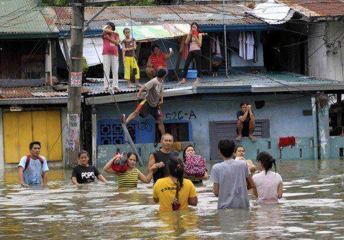 Der Sturm löste schwere Überschwemmungen aus. Bis zu 200.000 Menschen mussten ihre Häuser verlassen.  Foto: Reuters