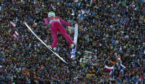 Der Norweger AndersJacobsen feierte erstmals seit Jänner 2013 wieder einen Weltcupsieg. Fotos: ap/epa