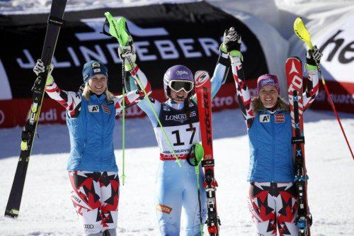 Feb 9, 2015; Beaver Creek, CO, USA; Tina Maze of Slovenia (middle) celebrates with Nicole Hosp of Austria (left) and Michaela Kirschgasser of Austria (right) after the women's alpine combined in the FIS alpine skiing world championships at Raptor Racecourse. Mandatory Credit: Jeff Swinger-USA TODAY Sports