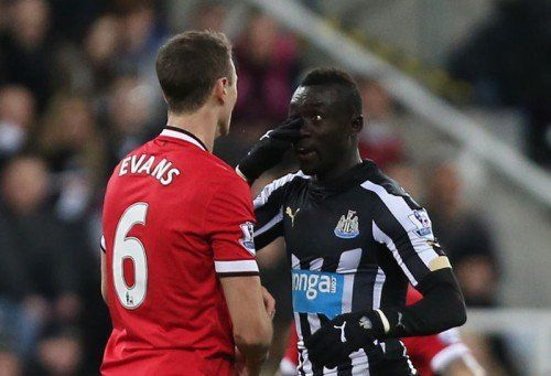 """Football - Newcastle United v Manchester United - Barclays Premier League - St James' Park - 4/3/15 Manchester United's Jonny Evans clashes with Newcastle's Papiss Cisse Action Images via Reuters / Lee Smith Livepic EDITORIAL USE ONLY. No use with unauthorized audio, video, data, fixture lists, club/league logos or """"live"""" services. Online in-match use limited to 45 images, no video emulation. No use in betting, games or single club/league/player publications. Please contact your account representative for further details."""