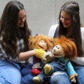 Puppen, Theater und Bilderbücher