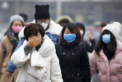 Extremer Smog macht den Bewohnern in Peking zu schaffen. AP