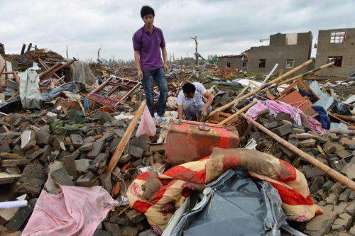 Am Tag nach den schweren Unwettern in Ostchina zeigt sich das ganze Ausmaß der Verwüstung.