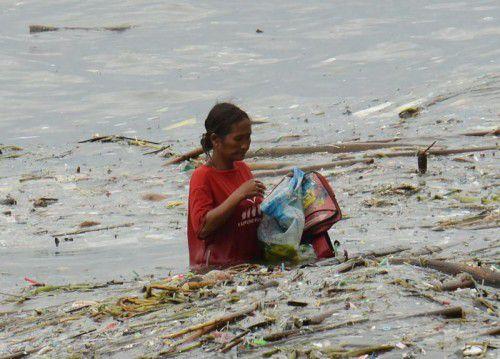 """Der Taifun """"Sarika"""" hat Tausende im Norden der Philippinen zur Flucht gezwungen. Zwei Menschen starben. Foto: AFP"""