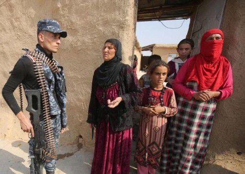 Rückkehr in die von Iraks Truppen eroberten Dörfer bei Mossul.  afp