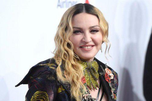 Popstar Madonna will Herzogin Meghan und Prinz Harry in die USA locken. AFP