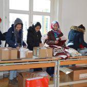 Huber Holding spendet Wäsche an die Caritas
