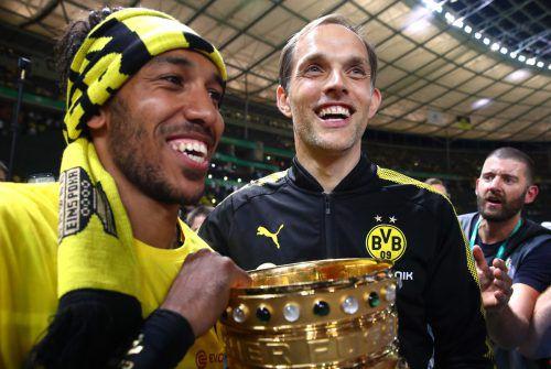 Für Pierre-Emerick Aubameyang und Trainer Thomas Tuchel könnte mit dem Pokalsieg die Zeit bei Dortmund zu Ende gehen. Foto: Reuters
