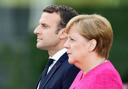 Macrons erste Auslandsreise als französischer Präsident führte zu Merkel nach Berlin. Foto: AFP