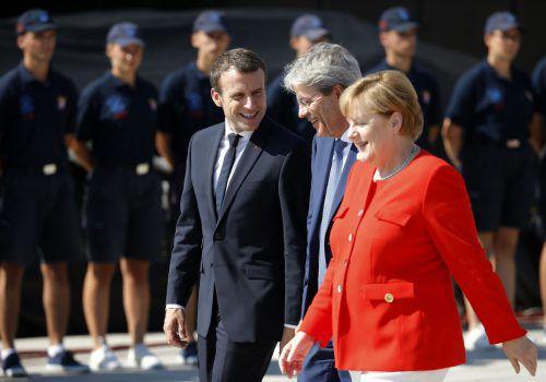 Macron, Gentiloni und Merkel berieten sich im Vorfeld des Westbalkan-Gipfels in Triest. Foto: AFP