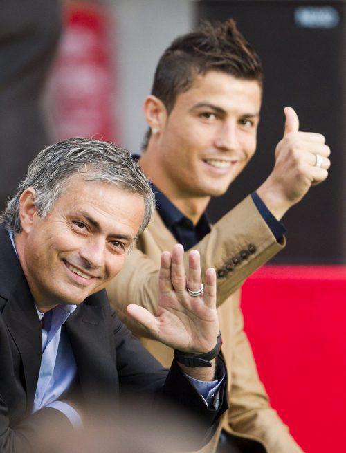 Heute als Gegner im Supercup: Mourinho und Ronaldo. Foto: ap