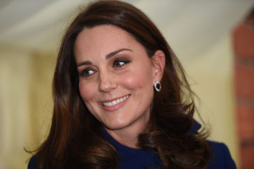 Britain's Catherine, Duchess of Cambridge smiles on a visit to officially open an Action on Addiction Community Treatment Centre in Wickford, east of London on February 7, 2018. The centre opened it's doors to clients in October and hosts a rolling cycle of 9-week long addiction recovery programmes. On the visit, the Duchess learned about the charity's community-based recovery programme 'Clouds in the Community', the starting point for long term recovery and abstinence, leading to improvements in participantsÕ physical and psychological health, self-efficacy, and overall quality of life. / AFP PHOTO / POOL / Eddie MULHOLLAND