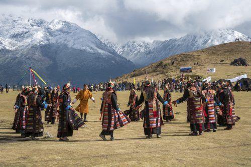 """Der buddhistische Zwergstaat hat sich seine historische Kultur weitgehend bewahrt. Das """"Laya Royal Highlander Festival"""" lockt seit zwei Jahren Touristen ins Land. ap"""