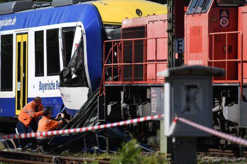Eine Regionalbahn ist auf einen Güterzug geprallt. Zwei Menschen starben. AFP