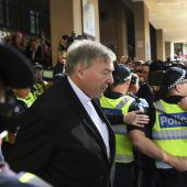 <p>Vatican finance chief Cardinal George Pell (C) leaves after making an appearance in court in Melbourne on May 1, 2018. Pell pleaded not guilty on May 1 after being ordered to stand trial on multiple historical sexual offence charges in Australia. / AFP PHOTO / WILLIAM WEST</p>
