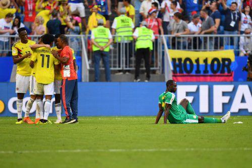 Am Ende konnten nur die Kolumbianer jubeln. Die Südamerikaner sicherten sich mit einem 1:0 über Senegal den Gruppensieg. Bitter für die Afrikaner: Sie sind das erste Team, das aufgrund der Fair-Play-Wertung ausscheidet.afp