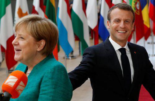 Angela Merkel und Emmanuel Macron kämpfen für europäische Lösungen im Migrationsstreit. reuters