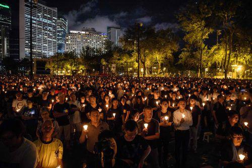 Hongkonger Demonstranten brechen zum Gedenken an Tian'anmen ein Tabu. afp
