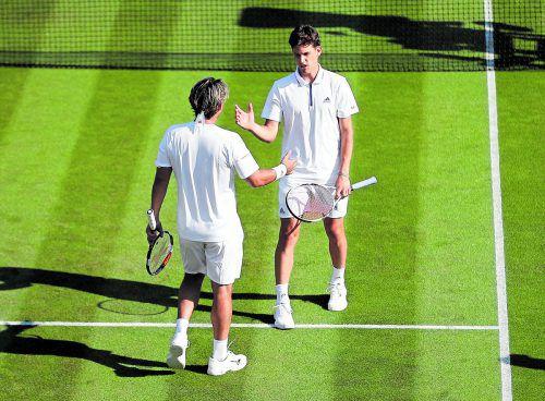 Früher Abschied aus Wimbledon. Dominic Thiem (r.) gab wegen einer Rückenverletzung gegen Marcos Baghdatis im dritten Satz auf.Reuters