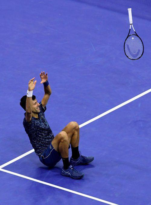 Der Moment der Glückseligkeit und Schwerelosigkeit: Novak Djokovic feiert seinen Erfolg im Endspiel der US Open 2018.afp