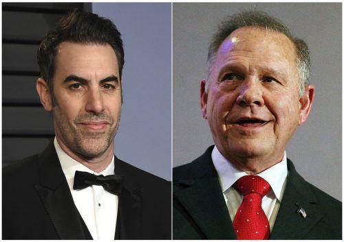 """Moore (r.) war Ende Juli als Gast in Baron Cohens Sendung """"Who is America?"""" aufgetreten und verließ die Sendung, als ihm indirekt Pädophilie unterstellt wurde. AP"""