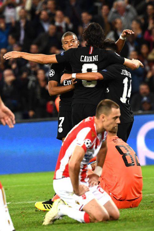 Das Bild spricht Bände: PSG-Spieler jubeln, Belgrads Akteure sind am Boden.afp
