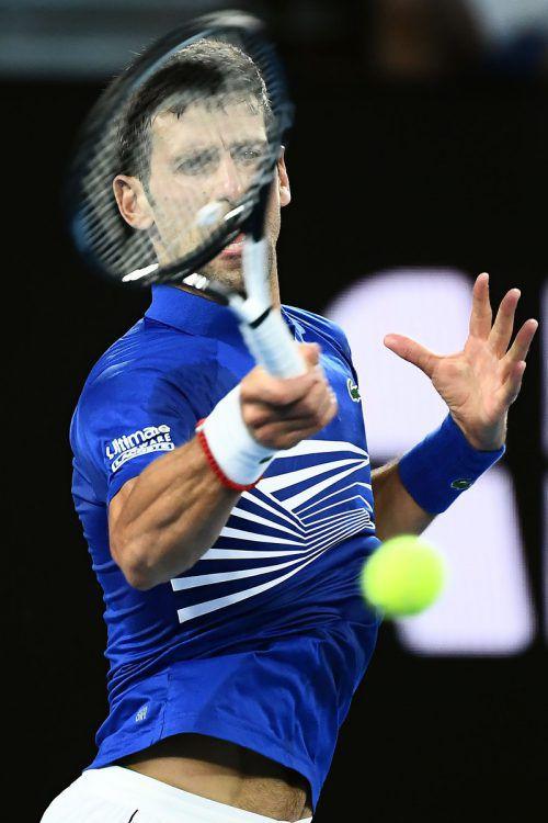 Der Weltranglisten-Erste Novak Djokovic greift nach einer überragenden Vorstellung nach seinem siebten Titel bei den Australian Open in Melbourne.AFP