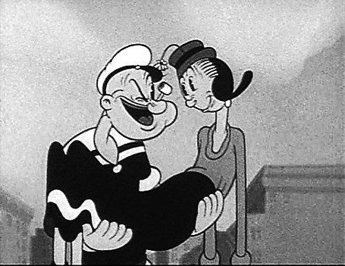 Unsterblich verliebt: Popeye trägt Olive Oyl auf Händen.
