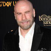 Travolta trägt mit 65 Glatze