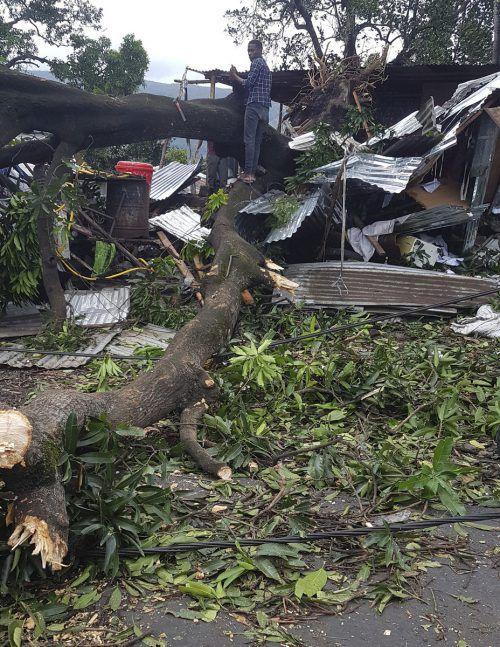 Im Bezirk Ibo wurden rund 90 Prozent der Häuser zerstört. AP
