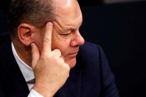 Finanzminister Scholz versucht demonstrativ, Ruhe zu bewahren.Reuters
